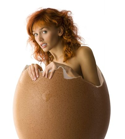 girl coming up from a broken egg like a chick Stock Photo