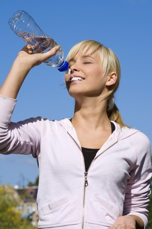 Beautiful girl drinking water under blue sky Stock Photo - 4423955