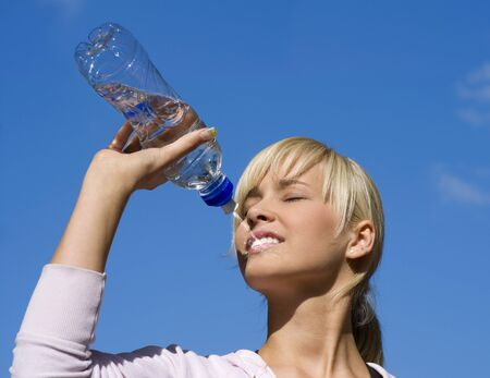 cute blond girl drinking water from a sport bottle Stock Photo - 4423961