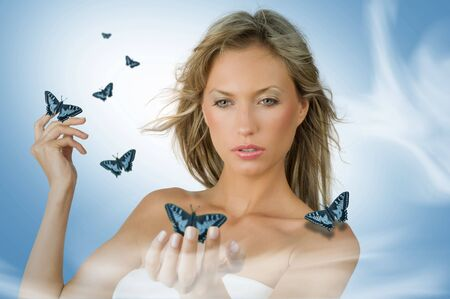 cute and sensual blond girl with blue flying butterfly all around her Stock Photo - 4480398