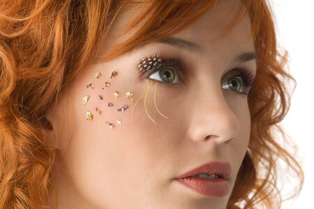 nice portrait of beautiful red haired girl with creative makeup photo