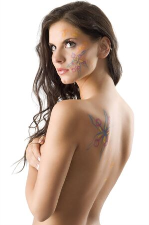 sensual brunette with a flower tattoo on her face and on her back photo
