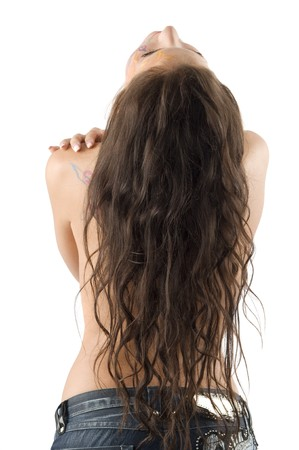 cute brunette with long hair falling on her nude back photo