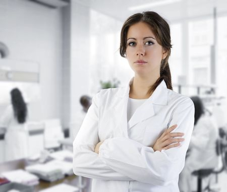 cute brunette in white medical gown in a research medical laboratory photo