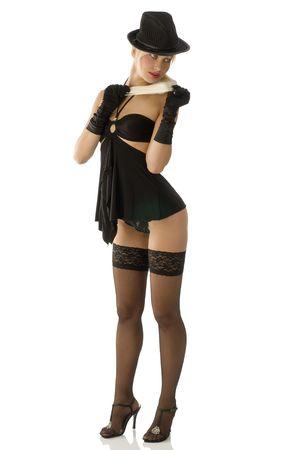 pinup sexy fille en noir avec chapeau bas et des souliers avec talons Banque d'images - 4616519
