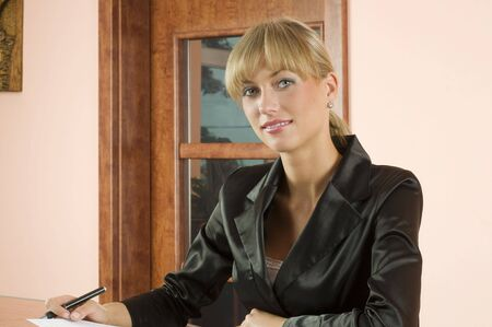 blond girl in Hotel reception with black formal dress photo