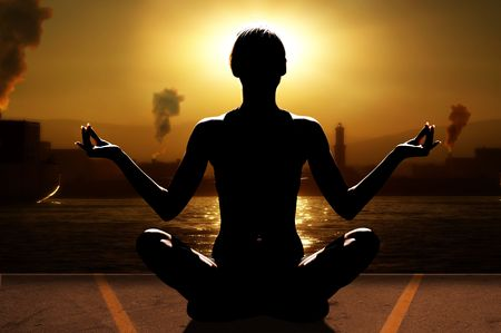 silhouette of woman in a sunset relaxing her mind with yoga near sea port with industry Stock Photo - 4652967