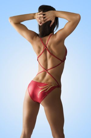 ass standing: sexy girl in red costume showing her back side muscle