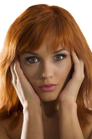 portrait of young nice woman red haired looking with expressive eyes photo