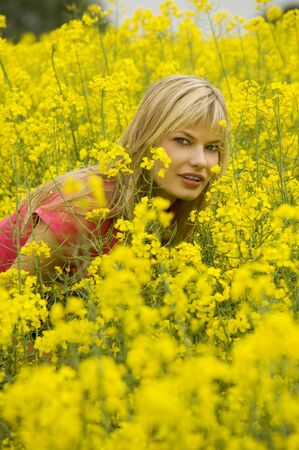 cute blond girl outdoor inside a yellow field Stock Photo - 4941547
