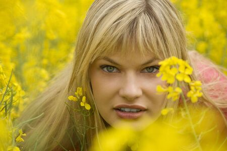 nice portrait of young blond girl in field with yellow flowers Stock Photo - 4941541