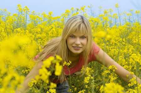 happy blond girl playing outdoor in a yellow field Stock Photo - 4941539
