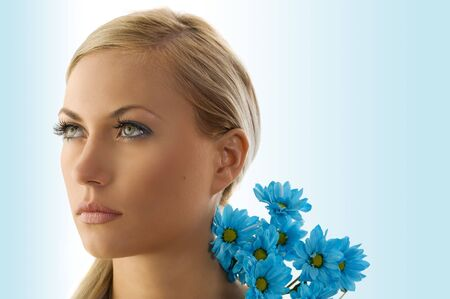 beauty portrait of pretty blond girl with blue daisy  Stock Photo - 5204930