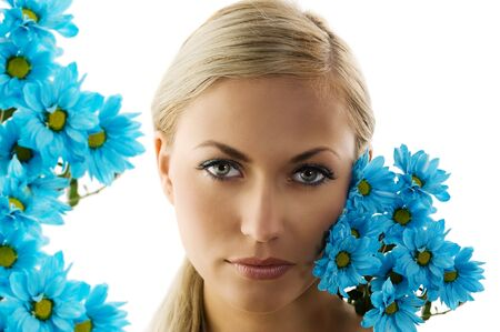 close up of a young blond woman with blue daisy near face Stock Photo - 5204932