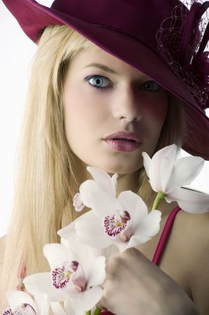 beautiful young woman with red hat and some orchid looking surprised Stock Photo - 5219403