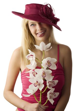 blond woman with red hat and flowers making funny face