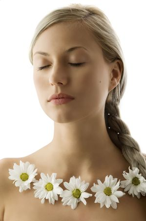 closed eyes portrait of a beautiful woman with twist braid and a flowers necklace