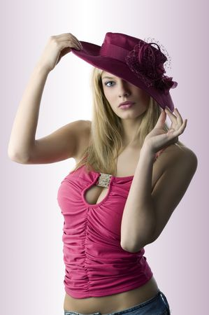 fedora hat: fashion portrait of beautiful blond woman with a vintage hat and red top