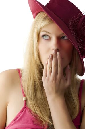 red head woman: cute blond woman with a red hat covering with hand the lips and looking surprised  LANG_EVOIMAGES
