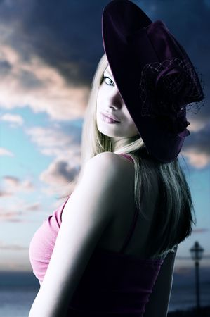 beautiful blond woman with a fashion red hat looking in camera Stock Photo - 5677094