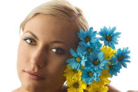 nice beauty portrait of pretty blond girl with blue and yellow daisy and colored makeup Stock Photo - 5288604