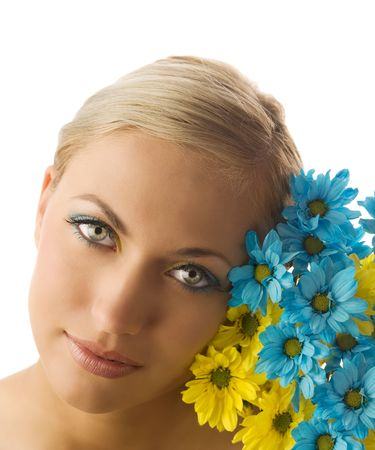 nice beauty portrait of pretty blond girl with blue and yellow daisy and colored makeup Stock Photo - 5288606