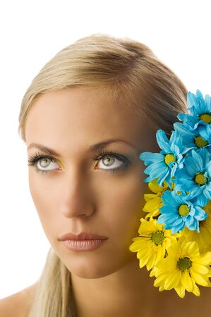 beauty portrait of pretty young blond girl with blue and yellow daisy and colored makeup Stock Photo - 5288605