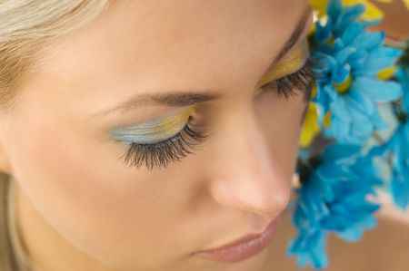 close-up of the girls eyes with colored make up and flowers Stock Photo - 5288602