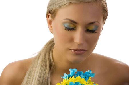 cute young woman with closed eyes and colored make up and daisy Stock Photo - 5288601