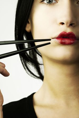 woman with classic  japanese make up on her lips and black chopstick Stock Photo - 5299493