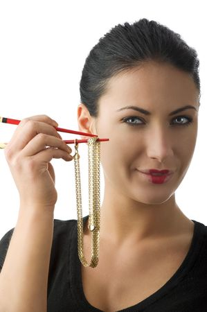 portrait of a cute woman with a gold necklace between red chopstick Stock Photo - 5299502