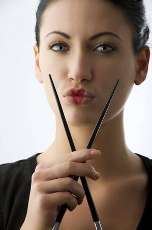 woman with classic  japanese make up on her lips and black chopstick Stock Photo - 5299488