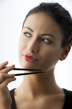 pretty woman with classic  japanese make up on her lips and black chopstick Stock Photo - 5299491