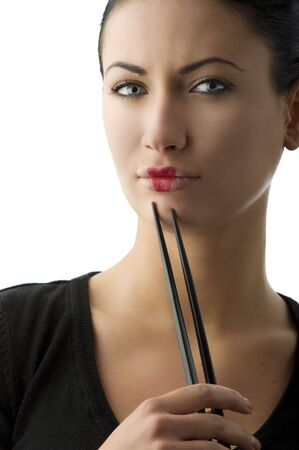 very beautiful woman with classic  japanese make up on her lips and black chopstick Stock Photo - 5299494