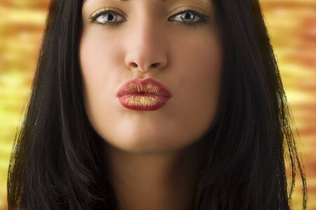 beautiful young woman with dark hair and creative lips giving a kiss Stock Photo - 5390127