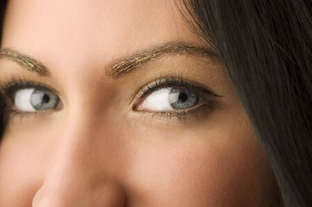stunning eyes close up of a beautiful woman with golden make up Stock Photo - 5390132