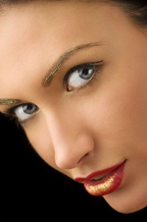 beauty portrait of cute brunette with golden make up on eyes looking in camera Stock Photo - 5390134