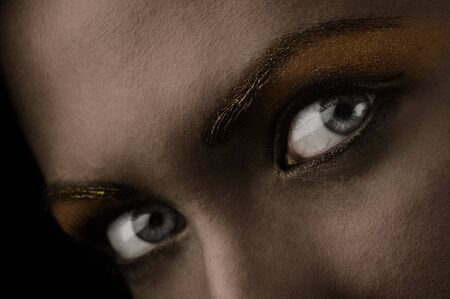 close up of stunning eyes in a dark desaturated shot Stock Photo - 5390131