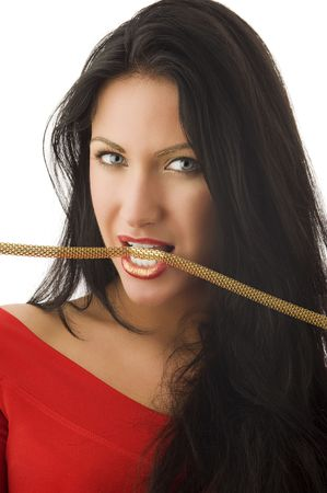 beautiful brunette in red top biting a golden collar Stock Photo - 5390135