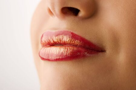 closeup of woman mouth with red and golden colored lips Stock Photo - 5501439