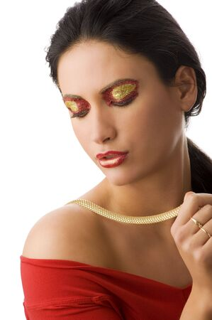 beautiful brunette with shining creative make up playing with a gold necklace Stock Photo - 5501450
