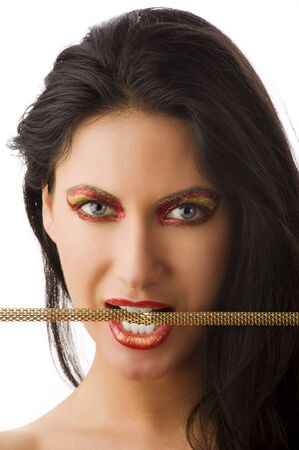beautiful brunette with shining creative make up biting a gold necklace Stock Photo - 5501447
