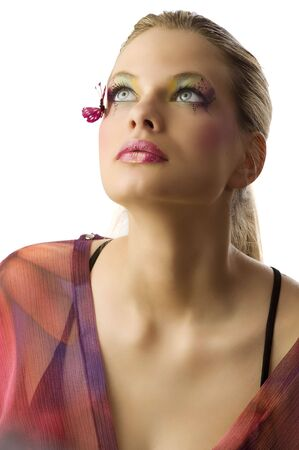 Beautiful blond woman with creative makeup with butterfly on her face looking up Stock Photo - 5501478