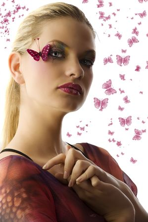 Beautiful woman in fashionable dress with creative makeup with butterfly on her face Stock Photo - 5501479