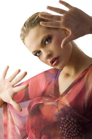 pretty blond girl in act to stop the camera of shooting with hands