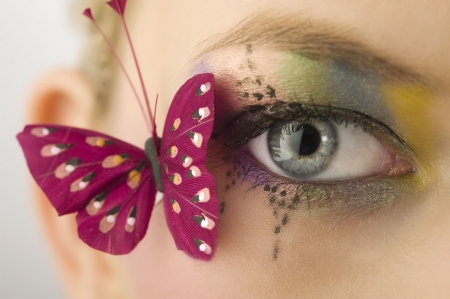 woman eye close up with creative makeup and a butterfly  Stock Photo - 5501484