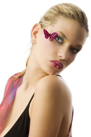 Beautiful woman in fashionable dress with creative makeup with butterfly on her face Stock Photo - 5501476