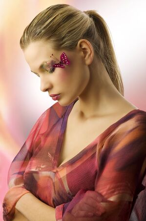 one side view of cute woman with closed eyes and creative make up with a butterfly Stock Photo - 5501481