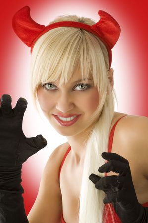 portrait  of a sexy and blond girl with demon red horns in agressive pose photo