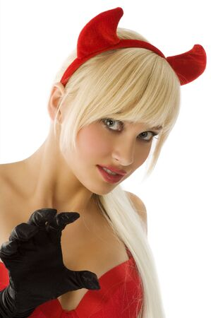 close up portrait of a sexy and blond demon with red horns and black gloves photo